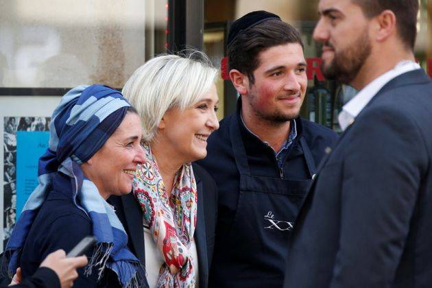 Marine Le Pen (C), French National Front (FN) political party leader and candidate for French 2017 presidential...