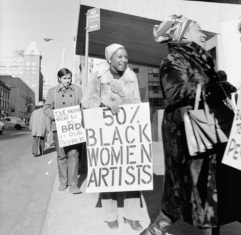 Jan van Raay's photo of Faith Ringgold (right) and Michele Wallace (middle) at an Art Workers Coalition protest at the Whitne
