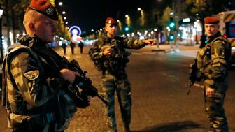 French soldiers stand guard on the Champs Elysees in Paris after a shooting on April 20, 2017. One police officer was killed and another wounded today in a shooting on Paris's Champs Elysees, police said just days ahead of France's presidential election. France's interior ministry said the attacker was killed in the incident on the world famous boulevard that is popular with tourists.  / AFP PHOTO / THOMAS SAMSON        (Photo credit should read THOMAS SAMSON/AFP/Getty Images)
