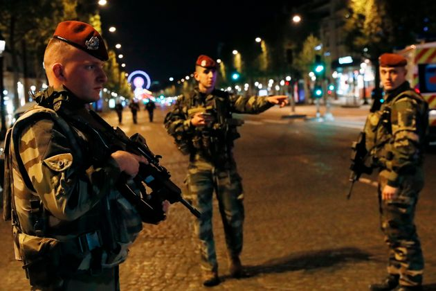 French soldiers stand guard on the Champs Elysees in Paris after a shooting on April 20,