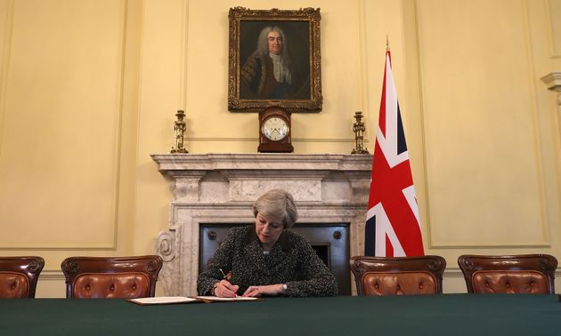 Theresa May signing the Article 50 letter triggering Brexit