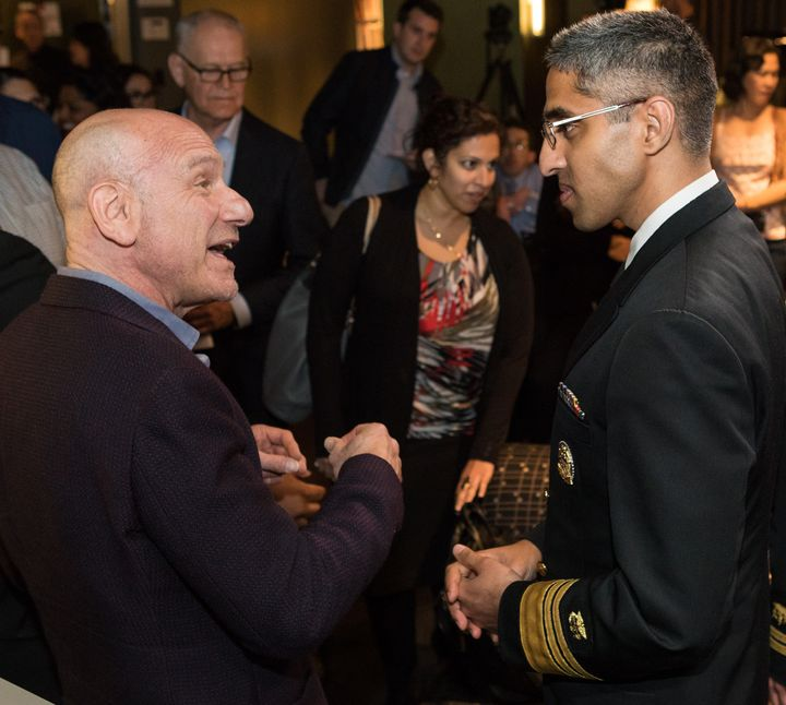 Surgeon general Vivek Murthy, right, and Marty Kaplan