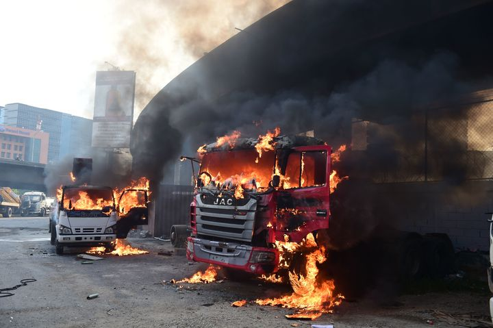 Trucks burn in flames during a demonstration by Venezuelan opposition activists against President Nicolas Maduro in Caracas.&