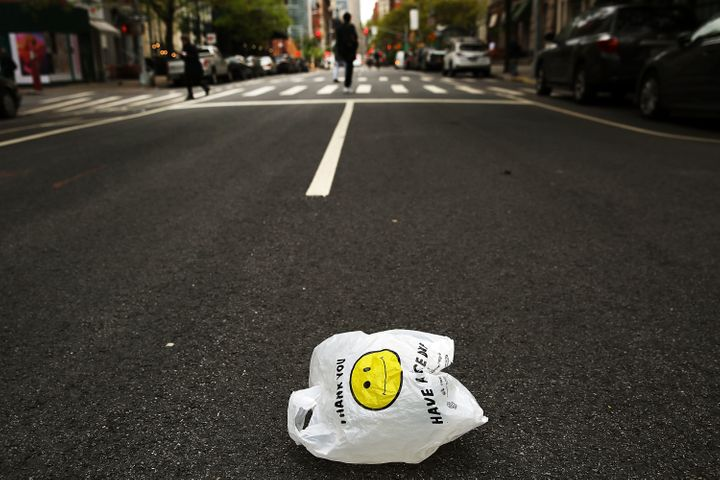 A plastic bag sits on a Manhattan street on May 5, 2016.Plastic bags are used for an average of 12 minutes each. But it could take up to 500 years or more for a plastic bag to degrade in a landfill.