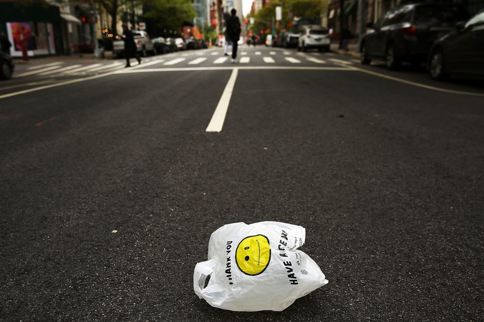 "A plastic bag sits on a Manhattan street on May 5, 2016.&nbsp;Plastic bags are used for an average of <a href=""https://www.5g"
