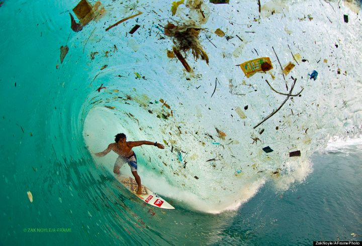 In 2012,photographer Zak Noyle captured the Indonesian surfer Dede Surinaya surfing in waters choked with trash off the coast of Java, Indonesia.