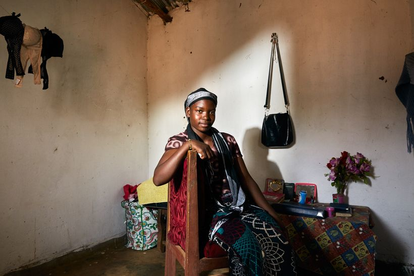 Tamanda (16) sits in her gowelo, Thyolo District, Malawi, 2016. After her mother passed away in 2007, Tamanda was sent to a l