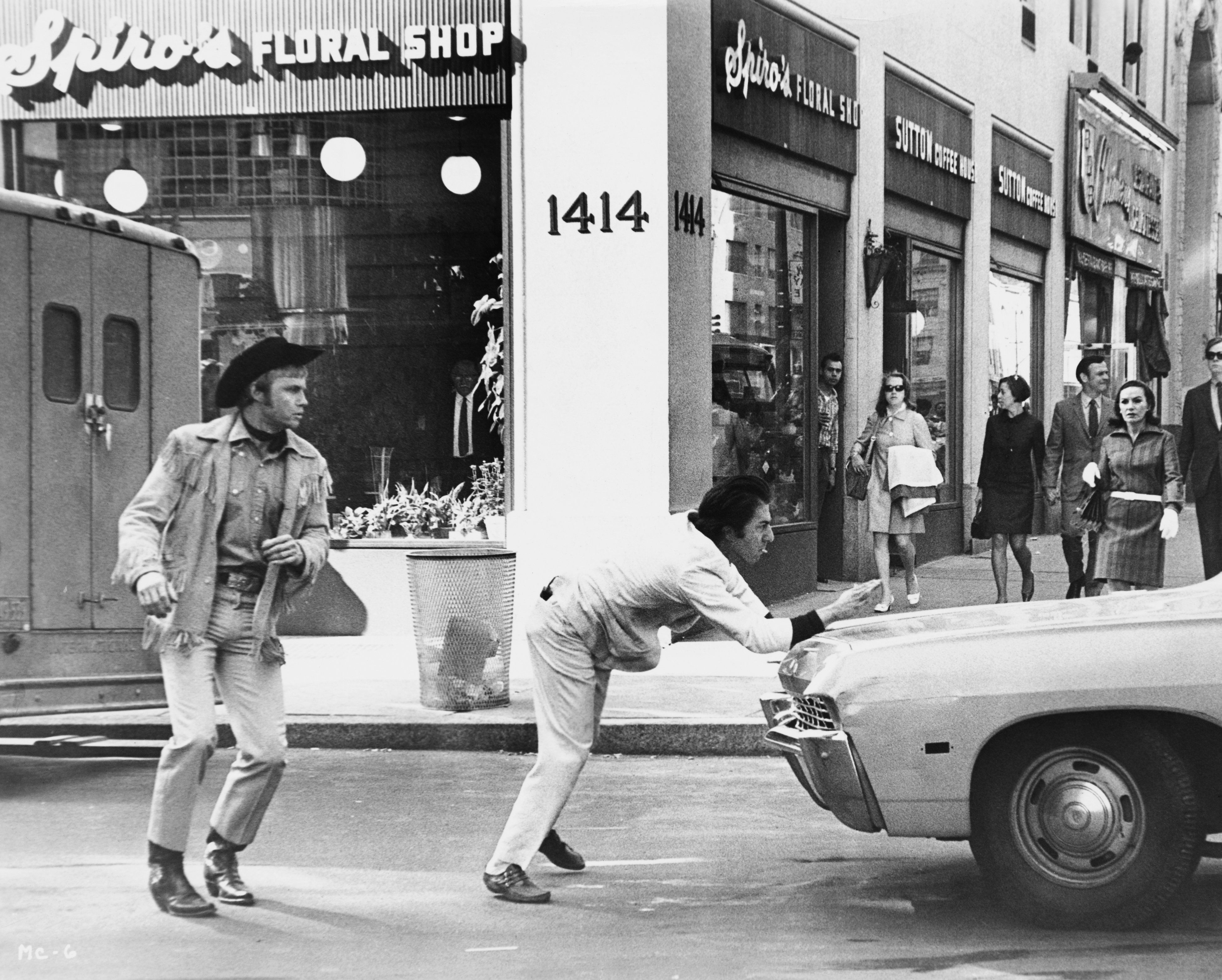 Joe Buck (Jon Voight) and Ratso Rizzo (Dustin Hoffman) rush across a street in front of traffic in Midnight Cowboy. (Photo by �� John Springer Collection/CORBIS/Corbis via Getty Images)