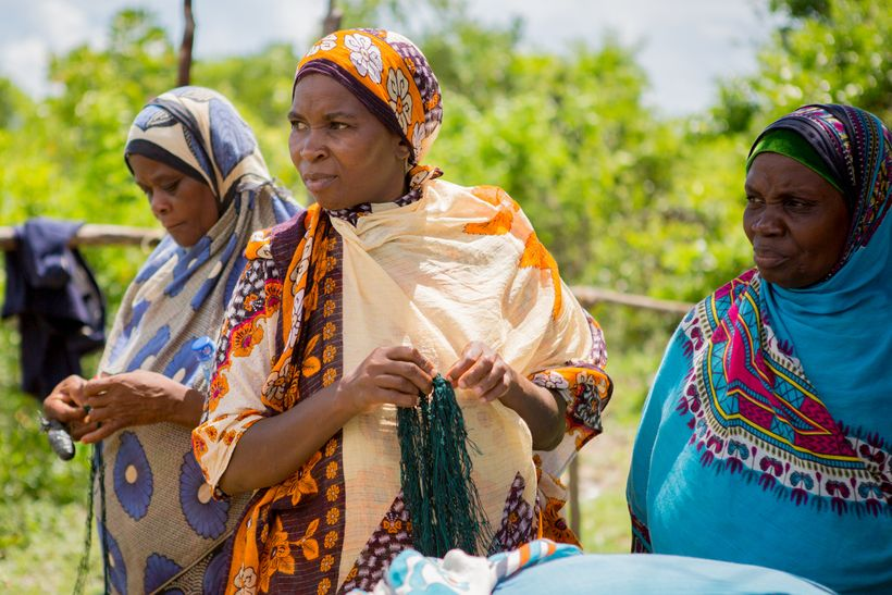 Women seaweed farmers from Zanzibar holding the tubular nets they have designed with SeaPower, a Blue Economy Challenge winne