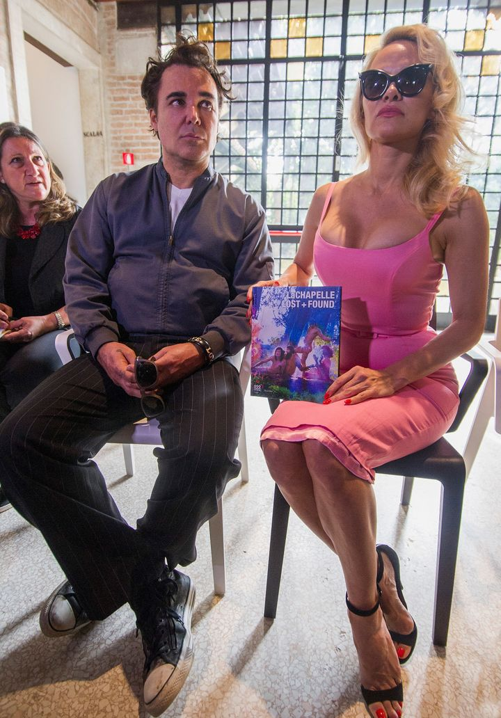 David La Chapelle and Pamela Anderson speak during a press preview for 'David LaChapelle: Lost + Found' on April 11 in Venice, Italy.