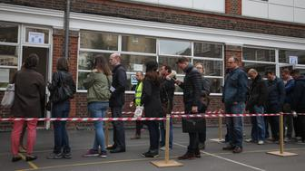 French citizens queue to vote at the polling stations at the Lycee Francais Charles de Gaulle in Kensington, London, as voting opens in one of the tightest French presidential elections in generations.