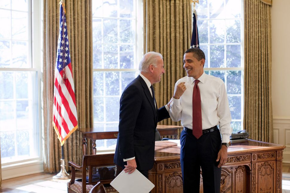 Obama and Vice President Joe Biden laugh together in the Oval Office on Jan. 22, 2009.