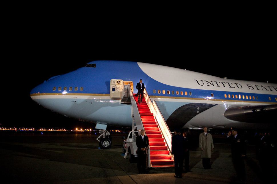Obama makes his way down the stairs of Air Force One on April 8, 2009, upon his arrival to Andrews Air Force Base returning f