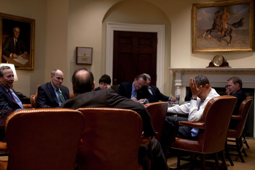 Obama meets with senior advisors in the Roosevelt Room of the White House on Feb. 16, 2009.
