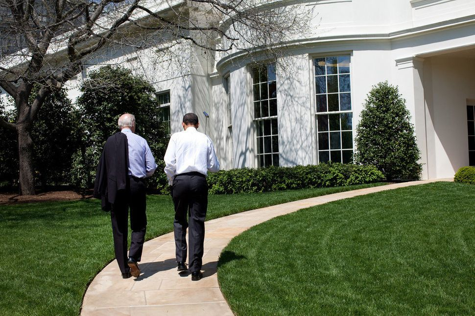 Obama and Biden walk back to the Oval Office after putting on the White House putting green on April 24, 2009.