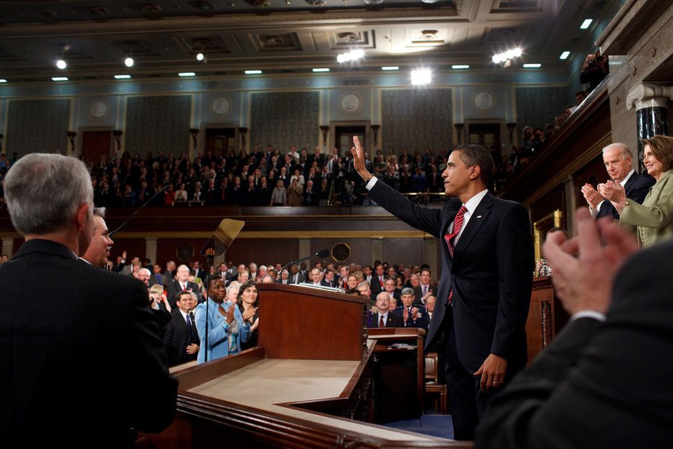 Obama waves to members of Congress before addressing the joint session of Congress at the U.S. Capitol on Feb. 24, 2009.