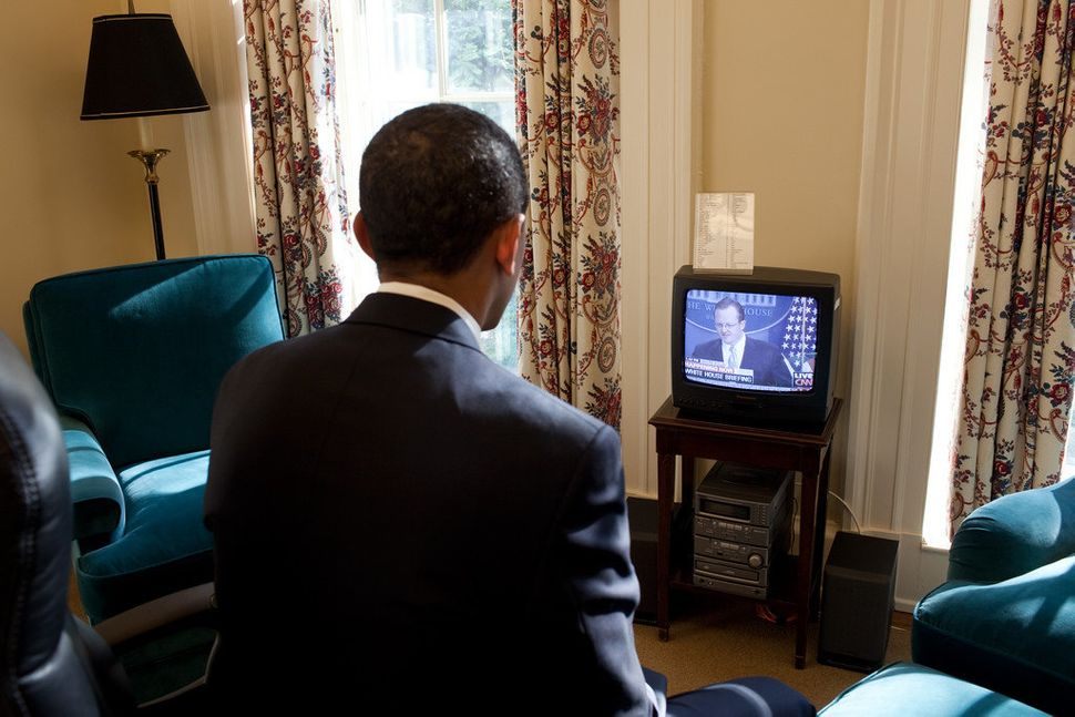 Obama watches Press Secretary Robert Gibbs' first press briefing on television, in his private study off the Oval Office on J