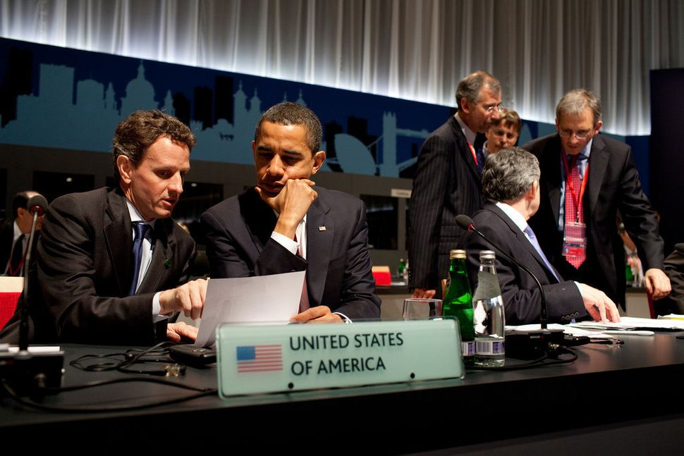 Obama confers with U.S. Treasury Secretary Timothy Geithner during the G-20 Summit on April 2, 2009, at the ExCel Centre in L