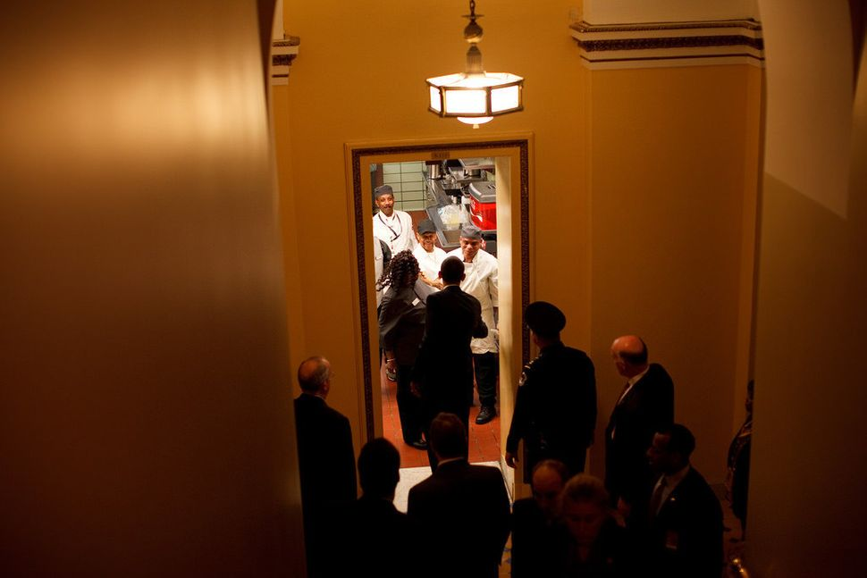 Obama greets kitchen staff before a lunch at the U.S. Capitol on Jan. 27, 2009.