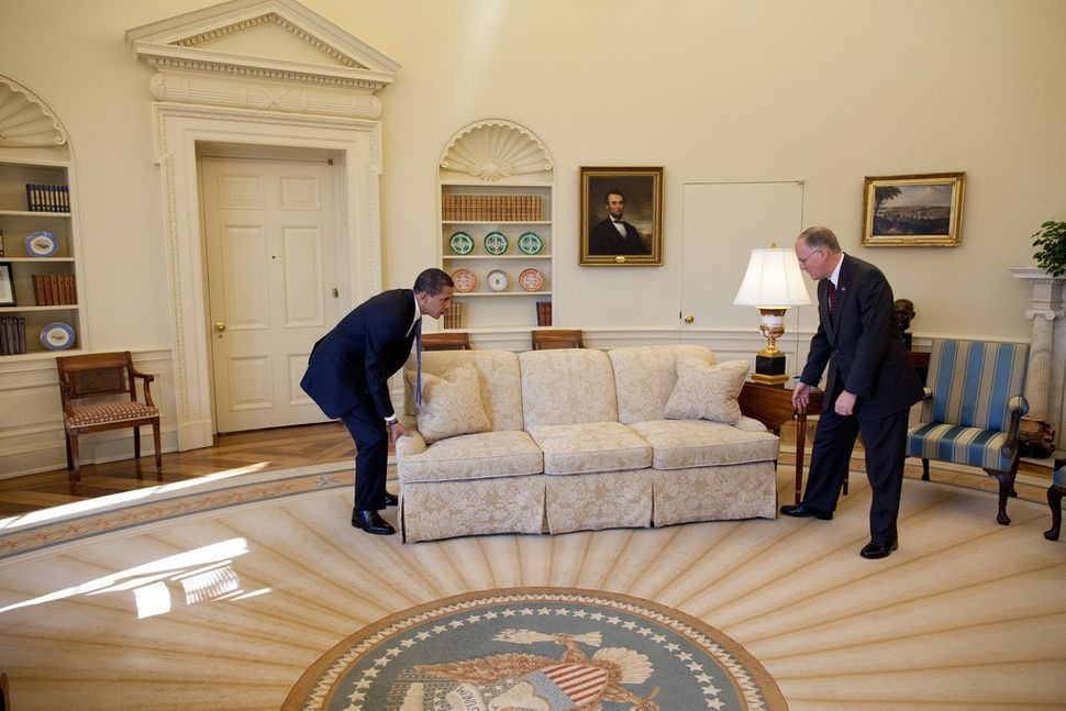 Obama and Vermont Gov. Jim Douglas move a couch in the Oval Office on Feb. 2, 2009. Douglas met with the president about the