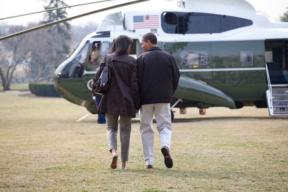 The president and the first lady walk to Marine One on the South Lawn before heading to Camp David on March 7, 2009.