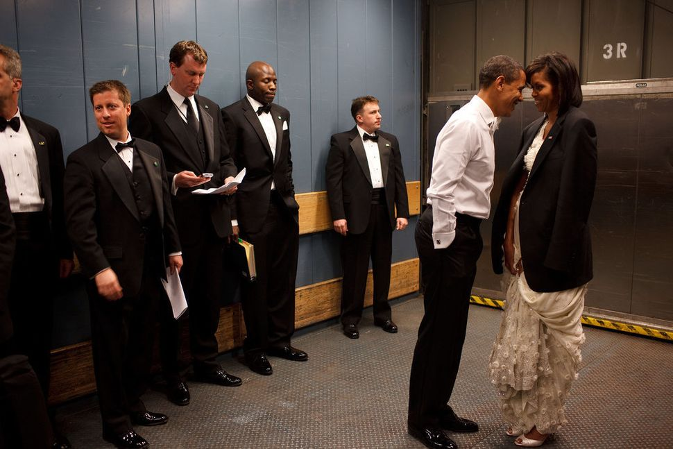 President Barack Obama and first lady Michelle Obama share a private moment in a freight elevator at an inaugural ball in Was