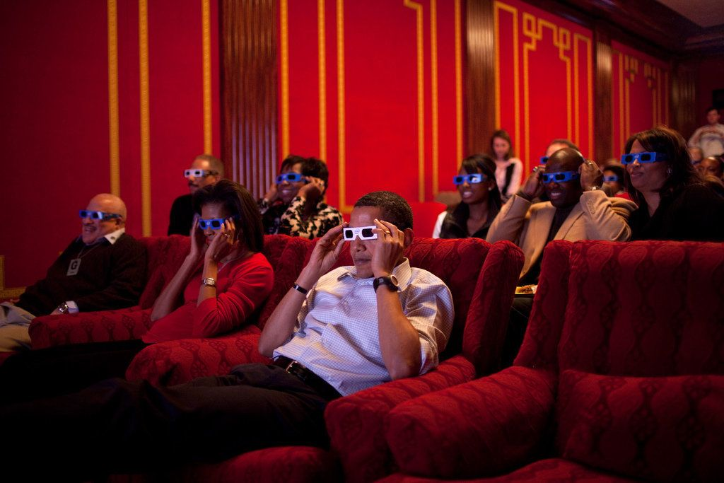 Obama and the first lady wear 3D glasses while watching a TV commercial during Super Bowl XLIII, Arizona Cardinals vs. P