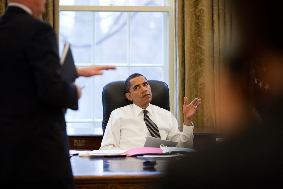 Obama is briefed before making phone calls to foreign leaders in the Oval Office on Jan. 26, 2009.