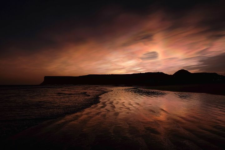 Nacreous clouds visible over cliffs on February 02, 2016 in Saltburn-by-the-Sea, England.