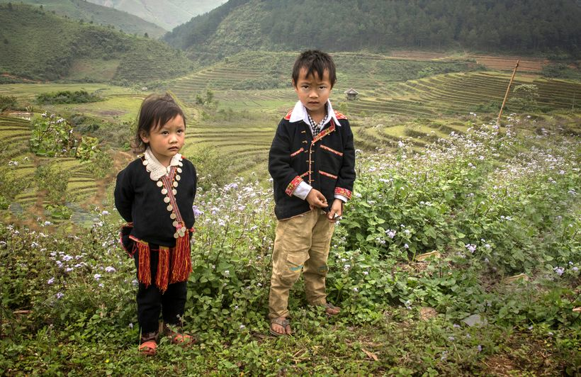 <strong>This brother and sister are members of the Dao ethnic minority in northern Vietnam.  They were walking home from scho