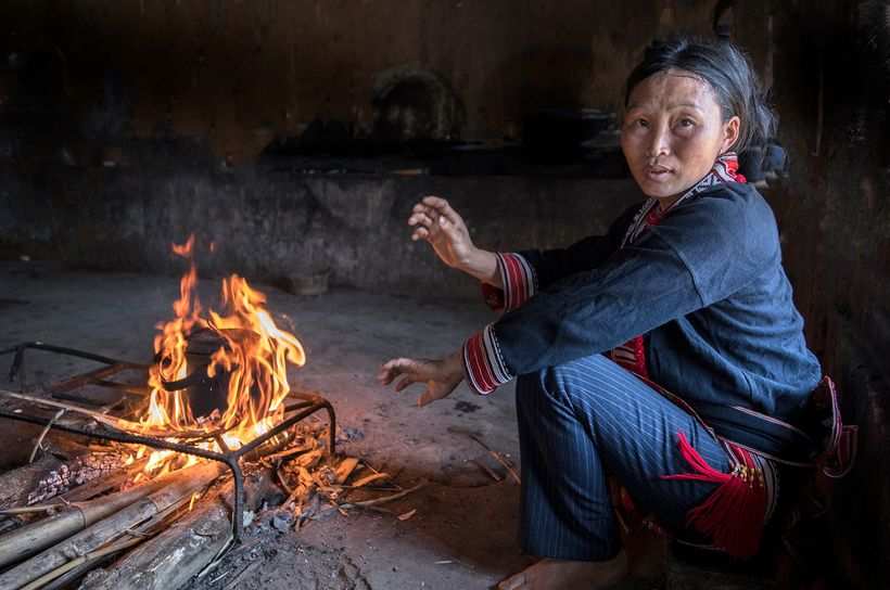 <strong>This woman is a member of the Tay ethnic group. She is boiling water to make green tea.  All cooking is done on a ope