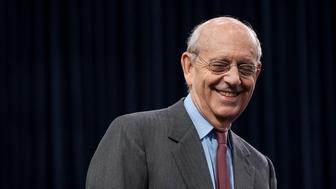 U.S. Supreme Court Justice Stephen Breyer smiles while waiting for the start of a Financial Services and General Government Subcommittee in Washington, D.C., U.S., on Monday, March 23, 2015. Sprinting toward their spring recess, the House and Senate will separately consider budget blueprints, perhaps leading to the first joint congressional budget in six years. Photographer: Pete Marovich/Bloomberg via Getty Images