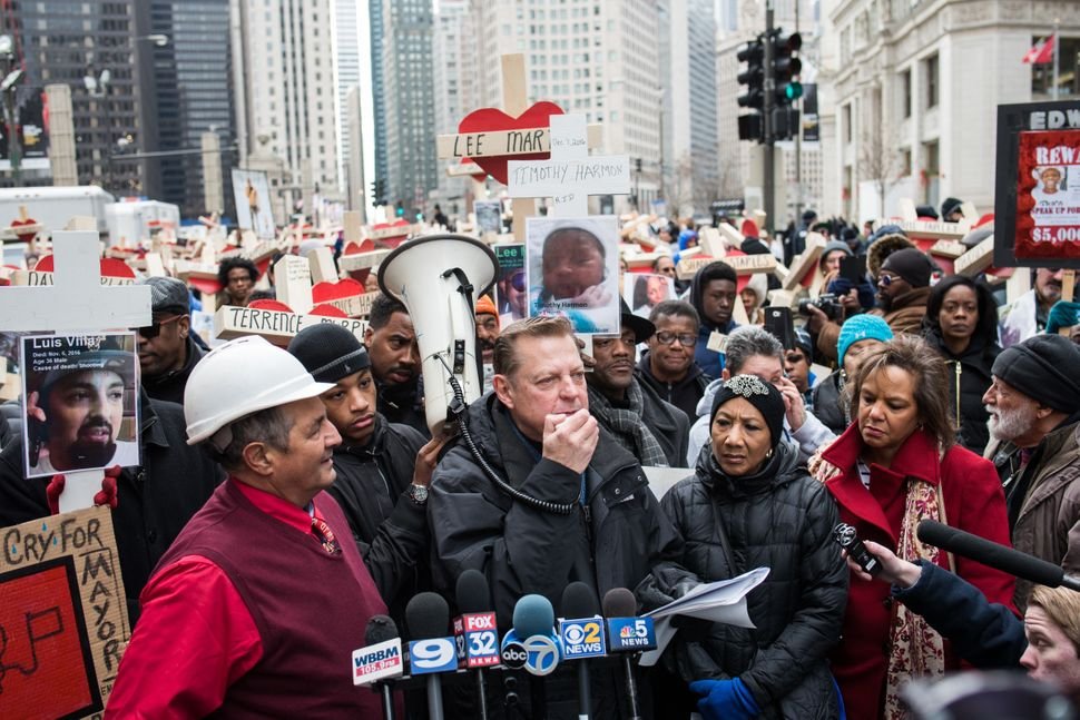 Father Michael Pfleger speaks at a peace march on Dec. 31, 2016, to remember the lives of over 750 peoplelost to violen