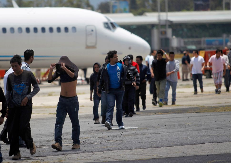Immigrants deported from Arizona arrive at an air force base in Guatemala City on July 22, 2014.