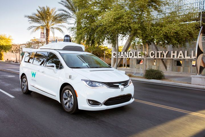 One of Waymo's self-driving minivans passes by the city hall in Chandler, Arizona, in this undated Waymo handout.