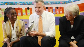 NEW YORK, NY - SEPTEMBER 4:   New York Mayor Bill de Blasio, along with First Lady Chirlane McCray (L), and Schools Chancellor Carmen Farina (R), visits Pre-K classes at Home Sweet Home Children's School in Queens on the first day of NYC public schools, September 4, 2014 in the Queens borough of New York City. New York Mayor Bill de Blasio is touring universal pre-kindergarten programs throughout the city. (Photo by Susan Watts-Pool/Getty Images)