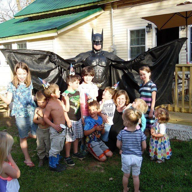 James dressed up as Batman at a birthday party.
