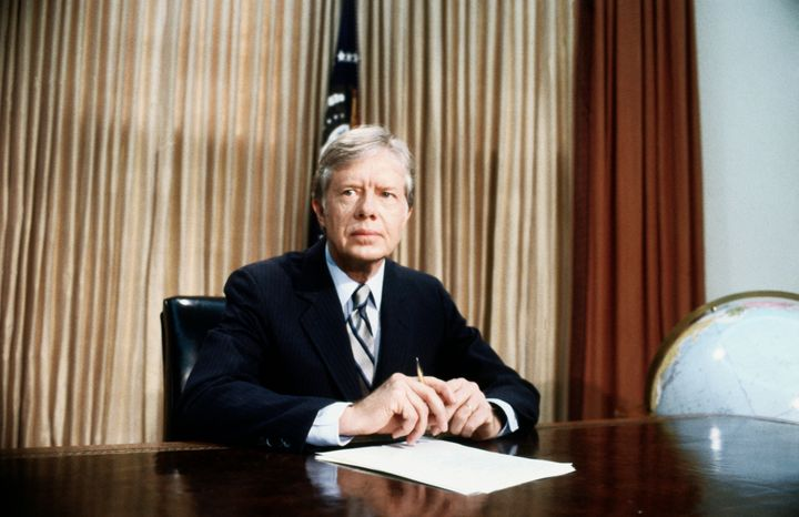 A grim-faced President Jimmy Carter, in the Oval Office, tells of the aborted rescue effort intended to free 53 American