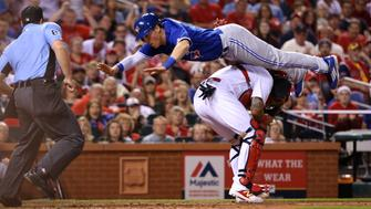 The Toronto Blue Jays' Chris Coghlan scores by leaping over St. Louis Cardinals catcher Yadier Molina in the seventh inning on Tuesday, April 25, 2017, at Busch Stadium in St. Louis. The Blue Jays won, 6-5, in 11 innings. (Christian Gooden/St. Louis Post-Dispatch/TNS via Getty Images)