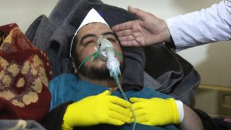 A Syrian man receives treatment at a small hospital in the town of Maaret al-Noman following a suspected toxic gas attack in Khan Sheikhun, a nearby rebel-held town in Syrias northwestern Idlib province, on April 4, 2017. Warplanes carried out a suspected toxic gas attack that killed at least 35 people including several children, a monitoring group said. The Syrian Observatory for Human Rights said those killed in the town of Khan Sheikhun, in Idlib province, had died from the effects of the gas, adding that dozens more suffered respiratory problems and other symptoms.  / AFP PHOTO / Mohamed al-Bakour / ADDING INFORMATION IN CAPTION        (Photo credit should read MOHAMED AL-BAKOUR/AFP/Getty Images)