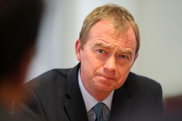 Liberal Democrat leader Tim Farron speaks to staff during a visit to the National Pharmacy Association...
