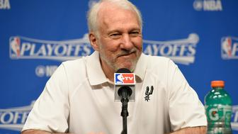 MEMPHIS, TN - APRIL 22:  Head coach Gregg Popovich of the San Antonio Spurs speaks to the media prior to game three of the Western Conference Quarterfinals against the Memphis Grizzlies during the 2016 NBA Playoffs at FedExForum on April 22, 2016 in Memphis, Tennessee. NOTE TO USER: User expressly acknowledges and agrees that, by downloading and or using this photograph, User is consenting to the terms and conditions of the Getty Images License Agreement.  (Photo by Frederick Breedon/Getty Images)