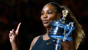 Tennis - Australian Open - Melbourne Park, Melbourne, Australia - 28/1/17 Serena Williams of the U.S. gestures as she holds her trophy after winning her Women's singles final match against Venus Williams of the U.S. .REUTERS/Edgar Su