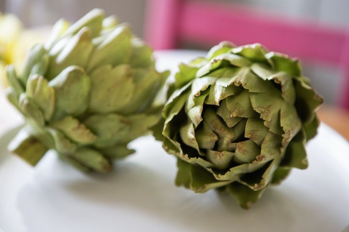 Two artichokes, spines and all.