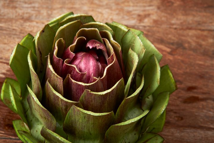 An artichoke that's been tamed by a kitchen knife.
