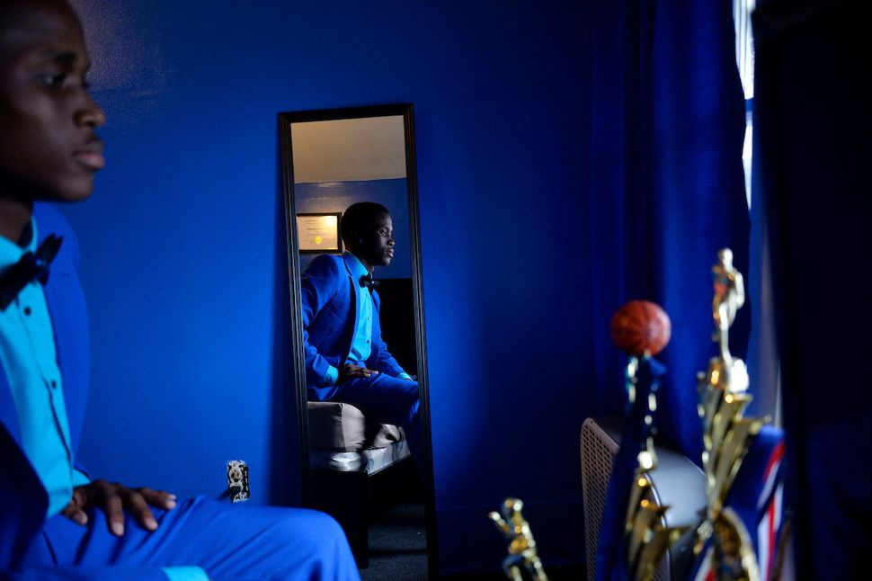 Flint Southwestern student Marcus Washington, 17, poses on Saturday, May 7, 2016 in his room in Flint, Michigan, ahead of&nbs