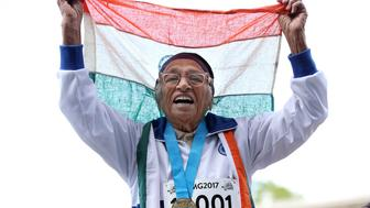 TOPSHOT - 101-year-old Man Kaur from India celebrates after competing in the 100m sprint in the 100+ age category at the World Masters Games at Trusts Arena in Auckland on April 24, 2017. / AFP PHOTO / MICHAEL BRADLEY        (Photo credit should read MICHAEL BRADLEY/AFP/Getty Images)