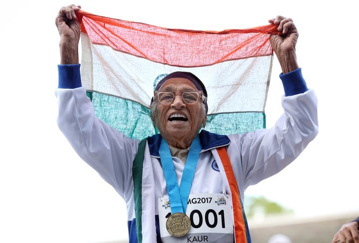 101-year-old Man Kaur from India celebrates after competing in the 100m sprint in the 100+ age category at the World Masters