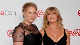 LAS VEGAS, NV - MARCH 30:  Actress/comedian Amy Schumer (L) and actress/producer Goldie Hawn, recipient of the Cinema Icon Award, attend the CinemaCon Big Screen Achievement Awards at Omnia Nightclub at Caesars Palace during CinemaCon, the official convention of the National Association of Theatre Owners, on March 30, 2017 in Las Vegas, Nevada.  (Photo by Tibrina Hobson/Getty Images)