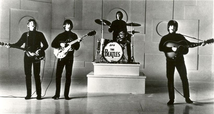 The Fab Four, complete with Beatle haircuts.